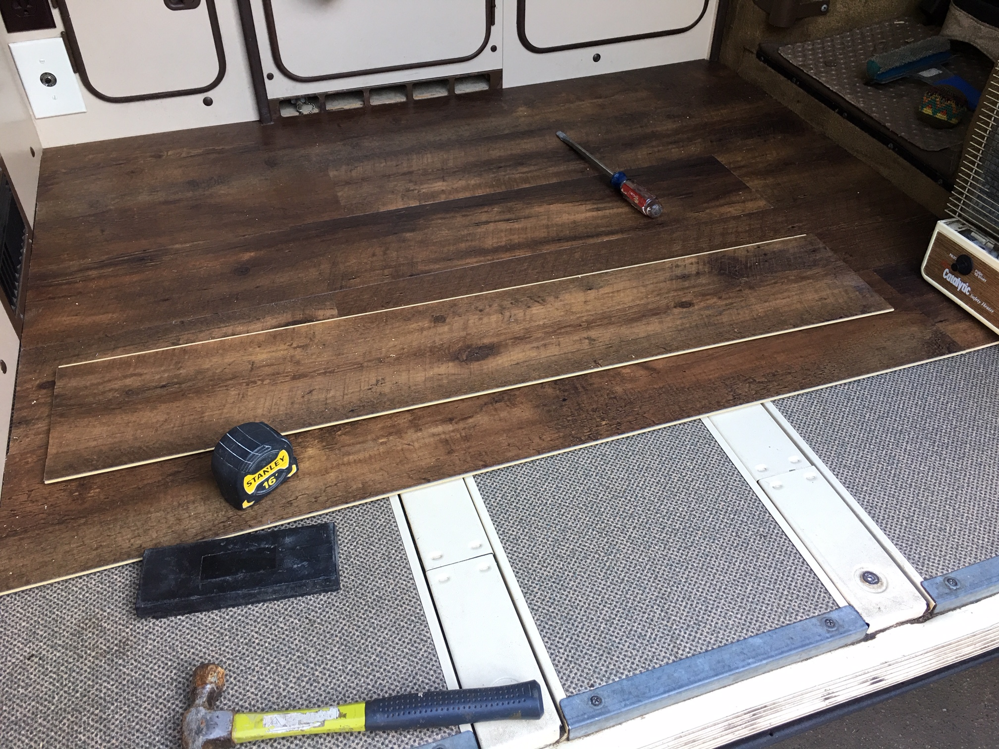 flooring being installed in the van