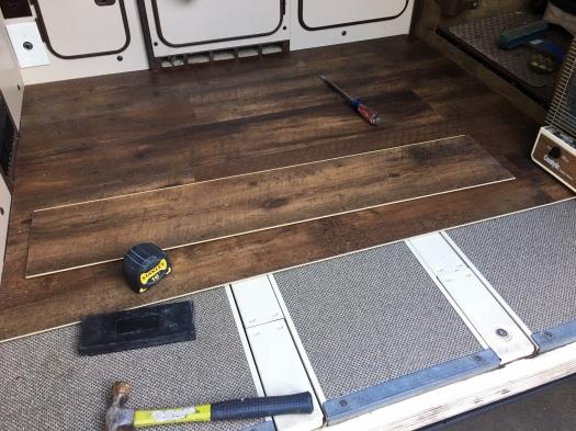 flooring being installed in the van